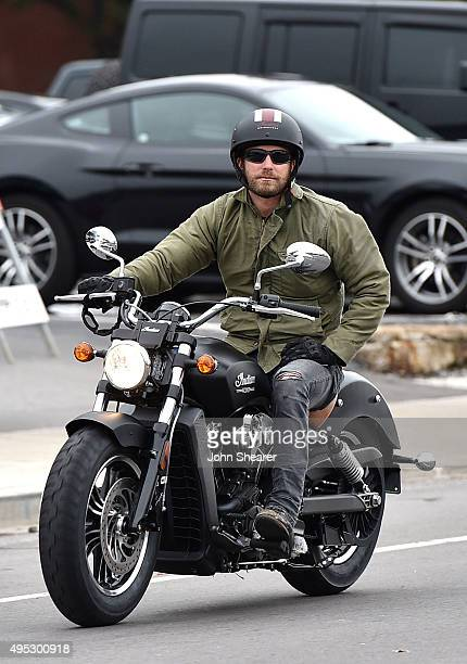 Musician Dierks Bentley arrives by motorcycle to the 10th anniversary 'Miles Music' concert on November 1 2015 in Nashville Tennessee