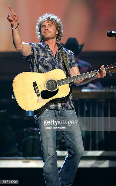 Musician Dierks Bentley performs on stage at the 38th Annual CMA Awards at the Grand Ole Opry House November 9 2004 in Nashville Tennessee