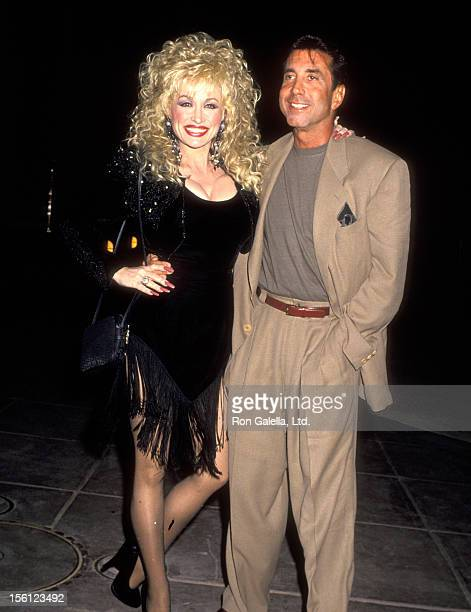 Musician Dolly Parton and Hollywood Manager/Producer Sandy Gallin attend the Barry Diller Hosts Sandy Gallin's 50th Birthday Celebration on May 27...