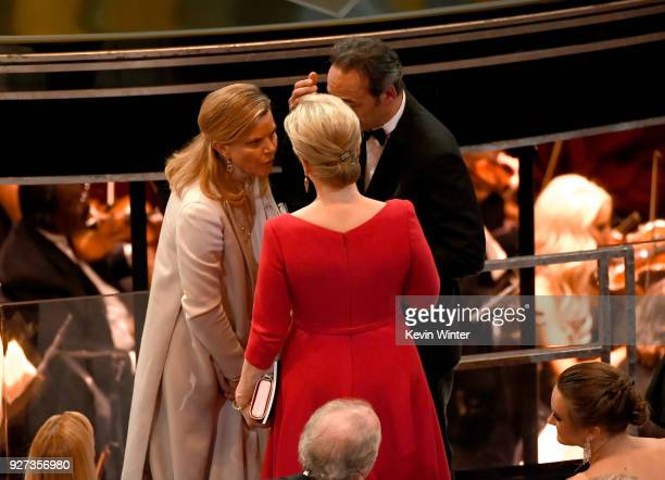 Musician Dominique Lemonnier actor Meryl Streep and composer Alexandre Desplat attend the 90th Annual Academy Awards at the Dolby Theatre at...
