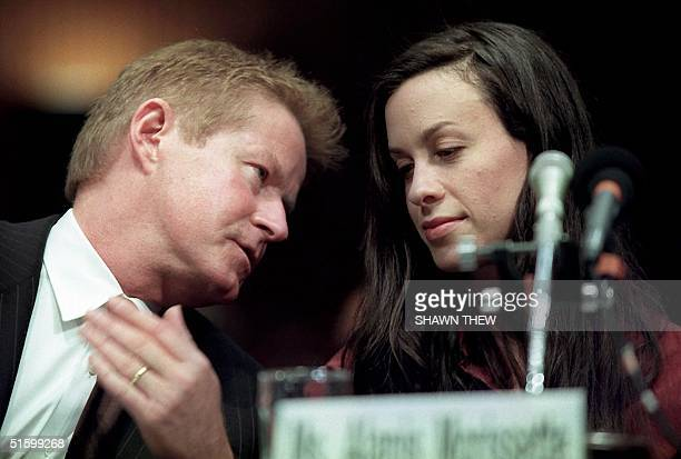 US musician Don Henley and singer Alanis Morissette confer during US Senate Judiciary hearings 03 April 2001 on Capitol Hill in Washington DC The...