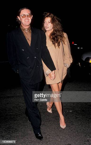 Musician Don Henley of The Eagles and date attending 'Miles Davis John Cougar Art Exhibit' on October 14 1989 at the Triangle Galleries in Beverly...