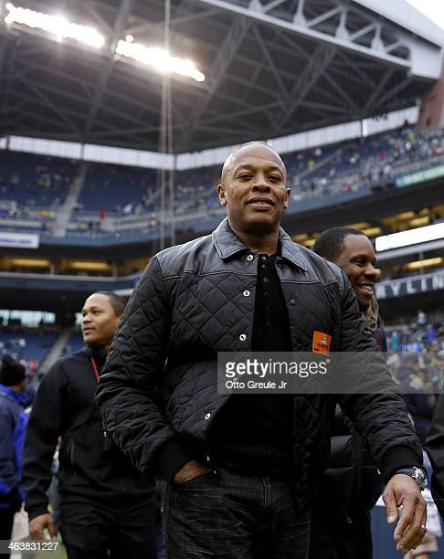 Musician Dr. Dre on the field before the Seattle Seahawks take on the San Francisco 49ers at CenturyLink Field on January 19, 2014 in Seattle,...