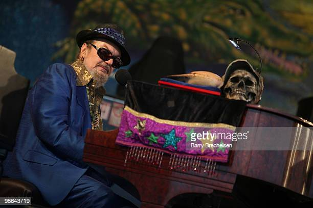 Musician Dr. John performs during day 1 of the 41st annual New Orleans Jazz & Heritage Festival at the Fair Grounds Race Course on April 23, 2010 in...
