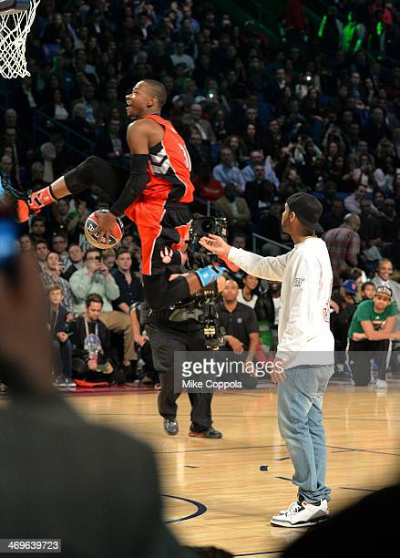 Musician Drake and Toronto Raptors player Terrence Ross participate in the Sprite Slam Dunk contest at the State Farm AllStar Saturday Night during...