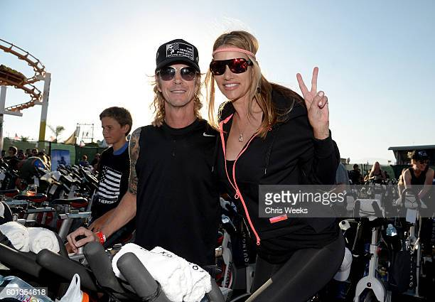 Musician Duff McKagan and TV personality Susan Holmes attend Cycle For Heroes 2016 at Santa Monica Pier on September 9 2016 in Santa Monica California