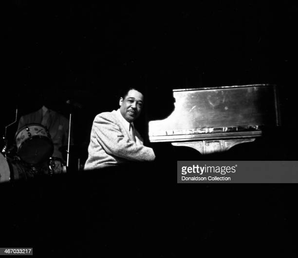 Musician Duke Ellington performs with his orchestra at the Paramount Theatre on April 21 1949 in New York New York