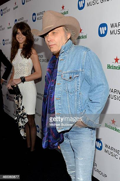 Musician Dwight Yoakam and Emily Joyce attend the Warner Music Group annual GRAMMY celebration on January 26 2014 in Los Angeles California