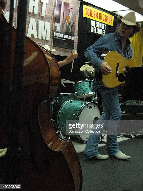 Musician Dwight Yoakam performs at Tower Records Sunset on June 14 2005 in Los Angeles California