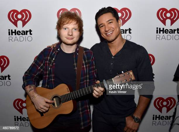 Musician Ed Sheeran and TV personality Mario Lopez pose backstage during the iHeartRadio Album Release Party with Ed Sheeran hosted by Mario Lopez...