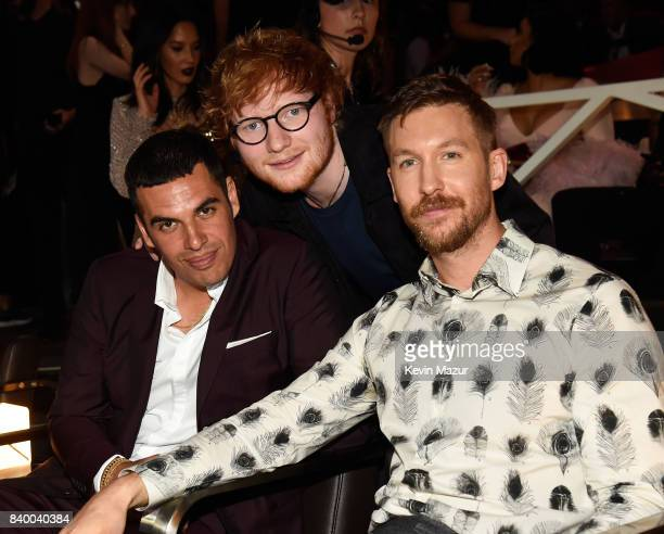 Musician Ed Sheeran DJ Calvin Harris and guest pose during the 2017 MTV Video Music Awards at The Forum on August 27 2017 in Inglewood California