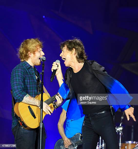 Musician Ed Sheeran joins musician Mick Jagger of The Rolling Stones during The Rolling Stones North American 'ZIP CODE' Tour at Arrowhead Stadium on...