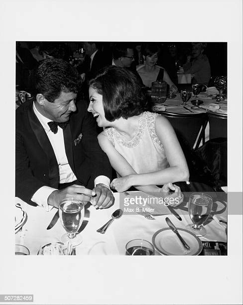 Musician Eddie Fisher and actress Barbara Parkins laughing together at singer Bobby Darin's Cocoanut Grove opening performance Los Angeles CA March...