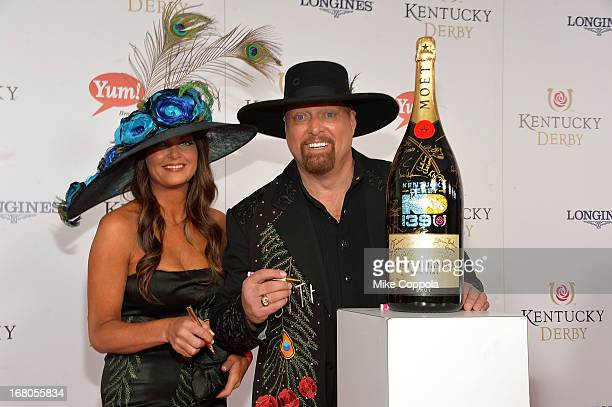 Musician Eddie Montgomery and Jennifer Belcher sign the Moet Chandon 6L for the Churchill Downs Foundation during the 139th Kentucky Derby at...