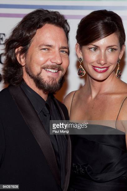 Musician Eddie Vedder and model Jill McCormick arrive at the 32nd Kennedy Center Honors at Kennedy Center Hall of States on December 6 2009 in...