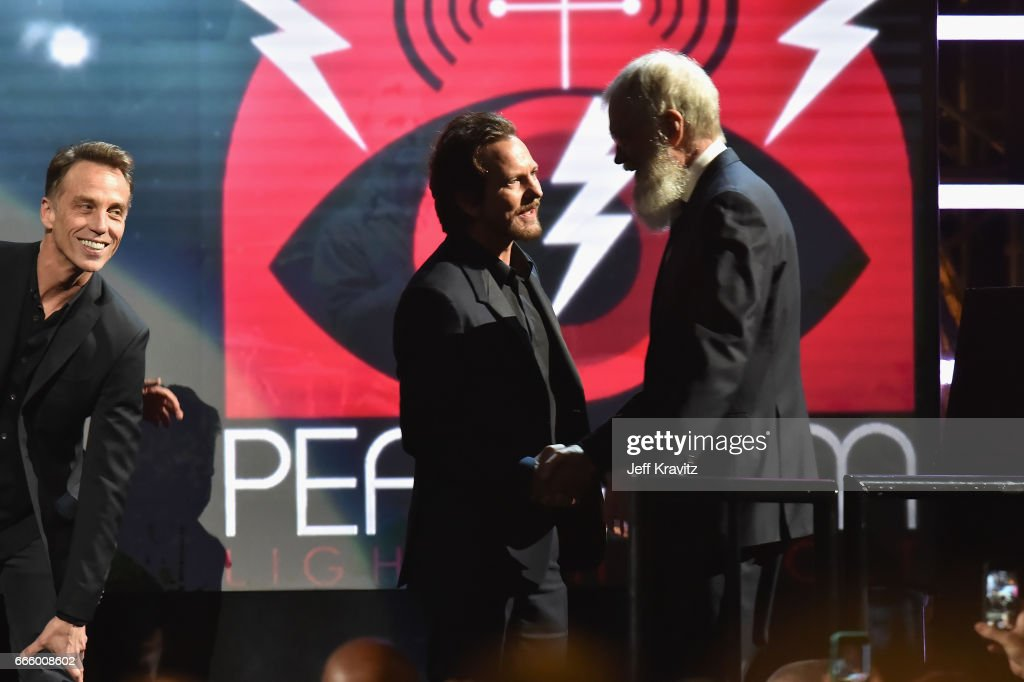 Musician Eddie Vedder greets Comedian David Letterman onstage at the 32nd Annual Rock & Roll Hall Of Fame Induction Ceremony at Barclays Center on April 7, 2017 in New York City. The event will broadcast on HBO Saturday, April 29, 2017 at 8:00 pm ET/PT
