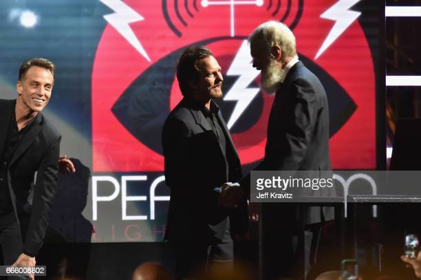 Musician Eddie Vedder greets Comedian David Letterman onstage at the 32nd Annual Rock Roll Hall Of Fame Induction Ceremony at Barclays Center on...