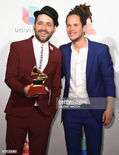 Musician Eduardo Cabra poses with the trophy for Producer of the Year along with Dominican singersongwriter Vicente García during the 18th Annual...