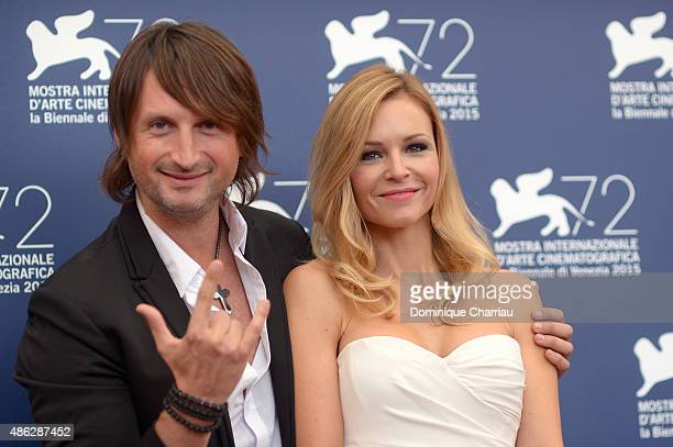 Musician Edvin Marton and his wife attend a photocall for 'Winter On Fire' during the 72nd Venice Film Festival at Palazzo del Casino on September 3,...