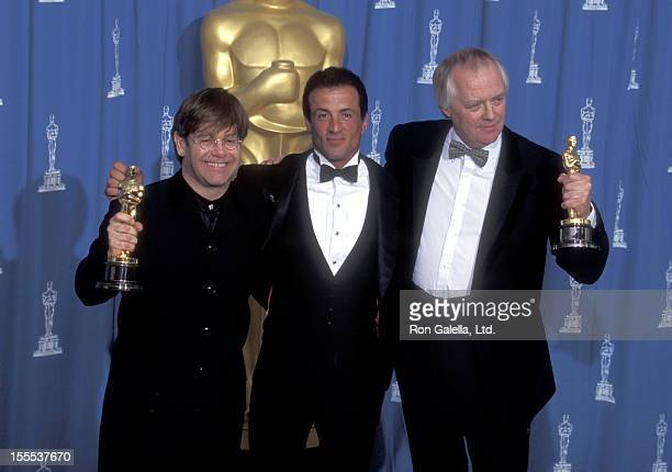 Musician Elton John actor Sylvester Stallone and lyricist Tim Rice attend the 67th Annual Academy Awards on March 27 1995 at Shrine Auditorium in Los...