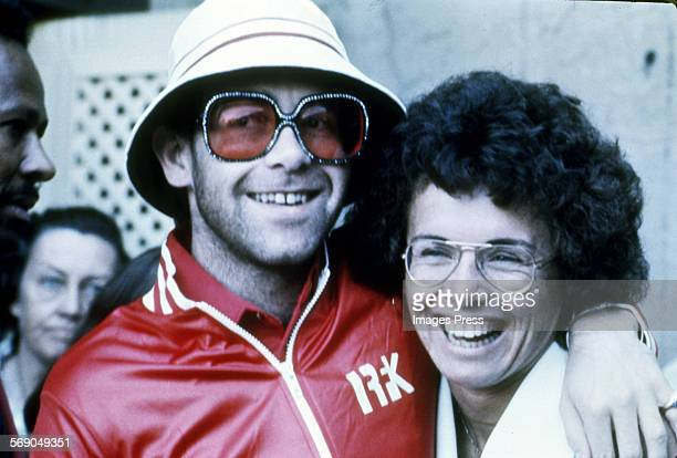 Musician Elton John and Billie Jean King photographed at the Forest Hills Tennis Stadium in New York City, circa 1975.