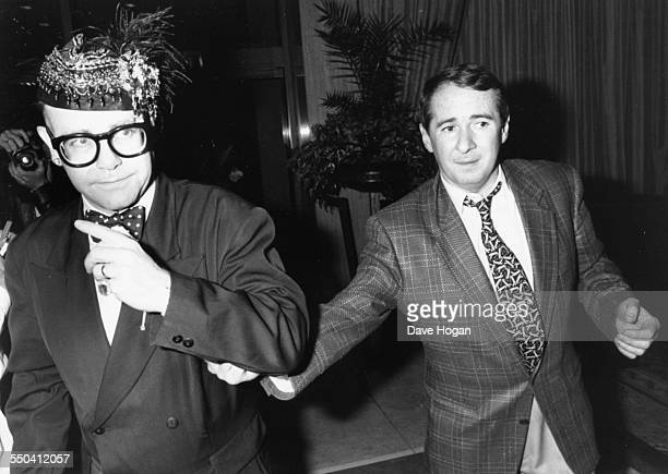 Musician Elton John and music manager John Reid attending a party held by Whitney Houston in London May 16th 1988