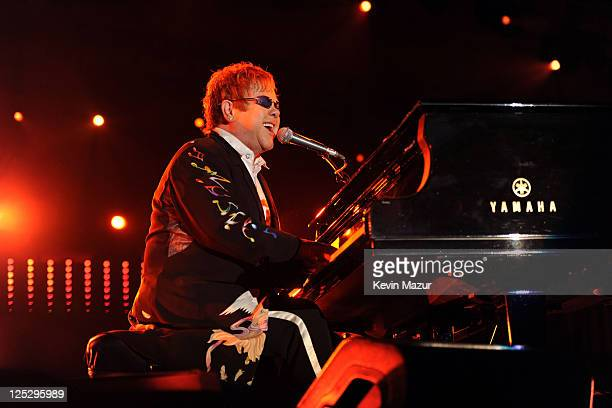 Musician Elton John performs on stage during the Andre Agassi Foundation for Education's 15th Grand Slam for Children benefit concert at the Wynn Las...