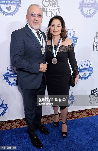Musician Emilio Estefan and singersongwriter Gloria Estefan attend the 30th Annual Great Sports Legends Dinner to benefit The Buoniconti Fund to Cure...