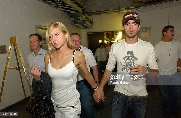 Musician Enrique Iglesias and former tennis player Anna Kournikova leave the arena at the end of Game Four of the 2006 NBA Finals between the Miami...