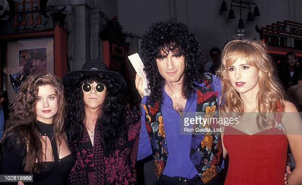 Musician Eric Carr of KISS date Carrie Stevens Bruce Kulick of KISS and date attending the premiere party for Bill Ted's Bogus Journey on July 11...