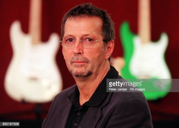 Musician Eric Clapton at Christies auction house in South Kensington London Clapton was announcing the sale of a selection of his guitars which...