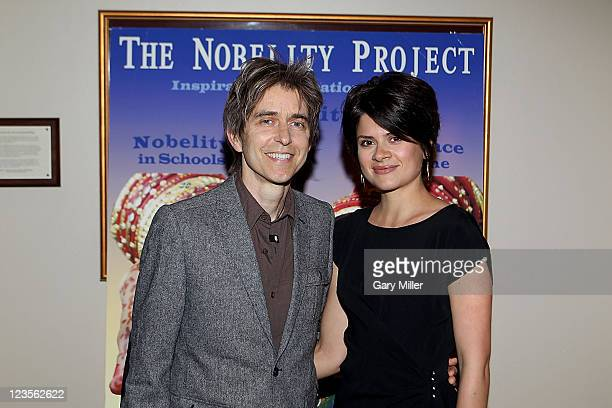 Musician Eric Johnson and guest on the red carpet during The Nobelity Project Dinner at the Four Seasons on April 10 2011 in Austin Texas