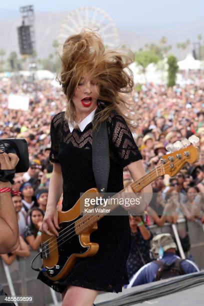 Musician Este Haim of HAIM performs onstage during day 1 of the 2014 Coachella Valley Music Arts Festival at the Empire Polo Club on April 18 2014 in...