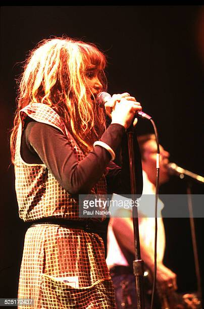 Musician Exene Cervenka of the band X performs Chicago Illinois July 21 1982 Behind her is bandmate John Doe