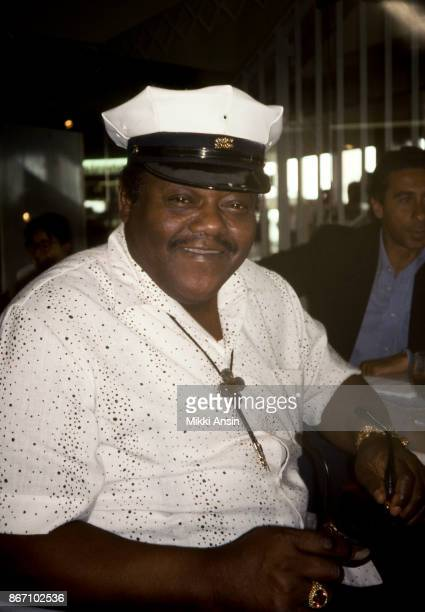 B musician Fats Domino sits in Charles de Gaulle Airport waiting for his plane in December 1997 in Paris France