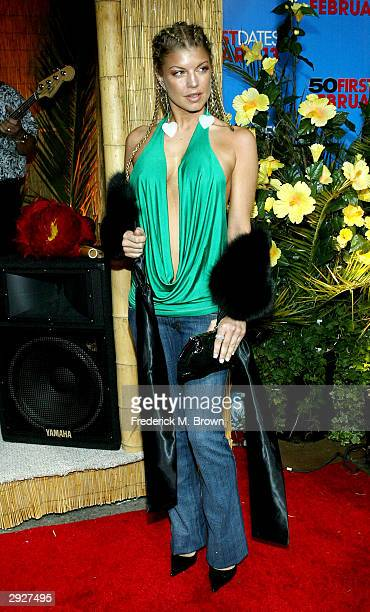 Musician Fergie arrives at the premiere of '50 First Dates' at the Mann Village on February 3 2004 in Westwood California