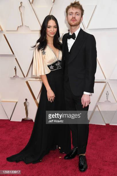 Musician Finneas O'Connell and Claudia Suleweski attend the 92nd Annual Academy Awards at Hollywood and Highland on February 09, 2020 in Hollywood,...