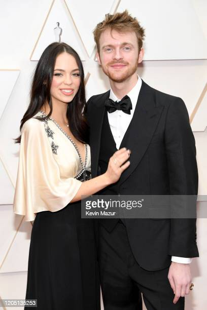Musician Finneas O'Connell and Claudia Suleweski attend the 92nd Annual Academy Awards at Hollywood and Highland on February 09 2020 in Hollywood...