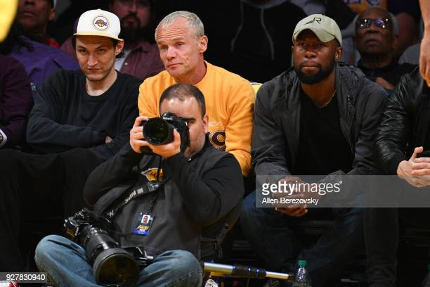Musician Flea and actor Trevante Rhodes attend a basketball game between the Los Angeles Lakers and Portland Trail Blazers at Staples Center on March...