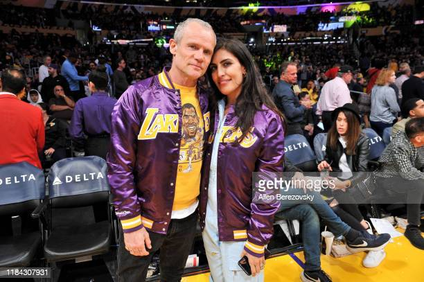 Musician Flea and Melody Ehsani attend a basketball game between the Los Angeles Lakers and the Memphis Grizzlies at Staples Center on October 29,...