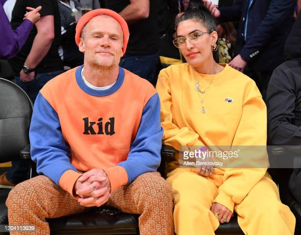 Musician Flea and Melody Ehsani attend a basketball game between the Los Angeles Lakers and the San Antonio Spurs at Staples Center on February 04,...