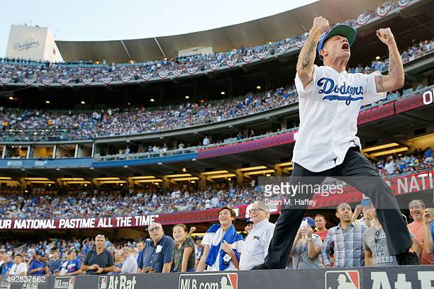 Musician Flea dances on the dugout in between innings while the Los Angeles Dodgers takes on the New York Mets in game five of the National League...