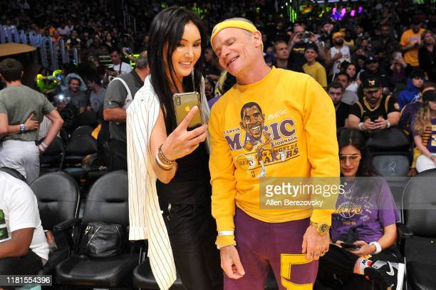 Musician Flea of Red Hot Chili Peppers attends a basketball game between the Los Angeles Lakers and the Golden State Warriors at Staples Center on...