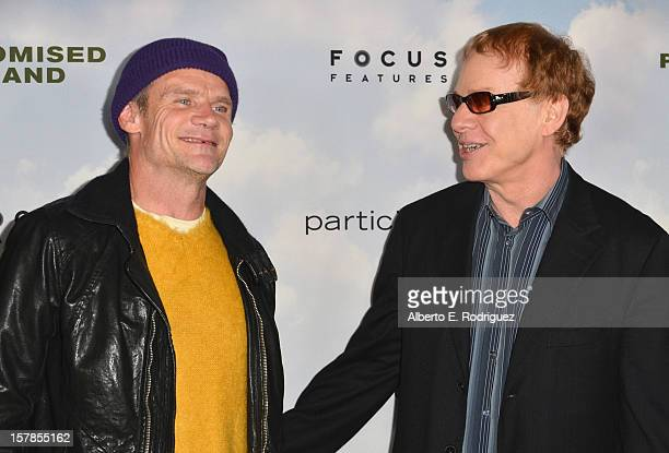 Musician Flea of The Red Hot Chili Pepers and Composer Danny Elfman arrives to the premiere of Focus Features' Promised Land at the Directors Guild...