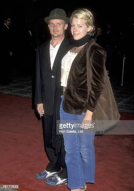 Musician Flea of the Red Hot Chili Peppers and Actress Amanda De Cadenet attend the 28th Annual NAACP Image Awards on February 9 1997 at Pasadena...