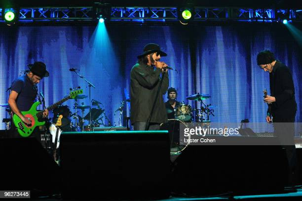 Musician Flea singer Anthony Kiedis and musician Josh Klinghoffer of the Red Hot Chili Peppers perform onstage at the 2010 MusiCares Person Of The...