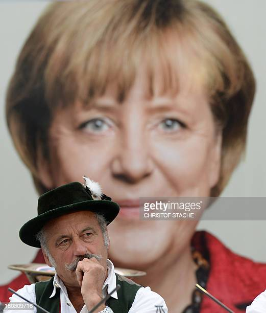 A musician follows the speech of German Chancellor Angela Merkel during a election campaign event of the German Christian Social Union Party in...