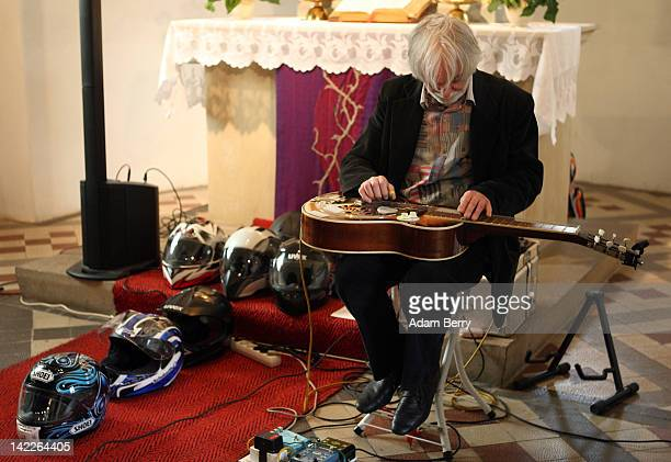 """Musician Fritz """"Kickass"""" Lucht plays lap steel guitar at an Ecumenical worship ceremony for the beginning of the 2012 motorcycling season in the..."""