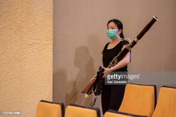 A musician from the Basque Symphony Orchestra carries her bassoon before the concert that will be broadcast by public television on May 28 2020 in...