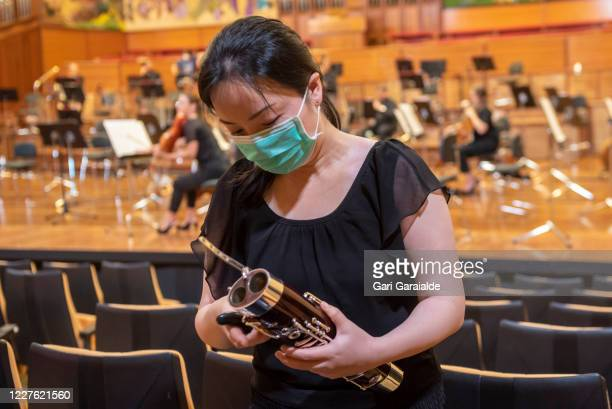 A musician from the Basque Symphony Orchestra prepares her bassoon before the concert that will be broadcast by public television on May 28 2020 in...